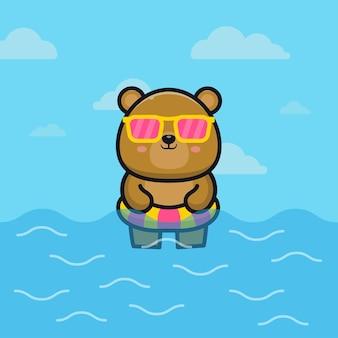 Netter bär mit schwimmringkarikaturillustrationstier-sommerkonzept
