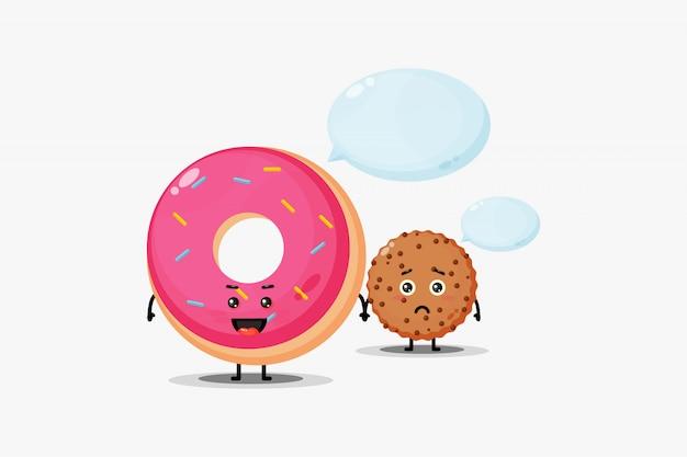 Netter donut und schokoladenkekse, die hand halten