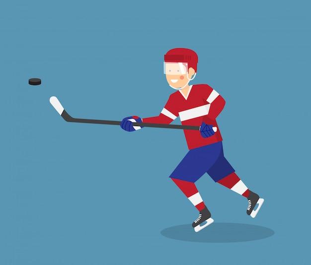 Netter eishockeyspieler mit stock und puck läuft im angriff