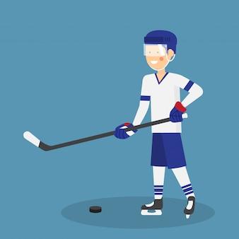 Netter eishockeyspieler mit stock und puck spielbereit