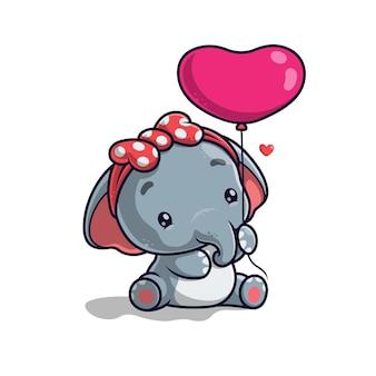 Netter elefant, der einen ballon lokalisiert auf weiß hält
