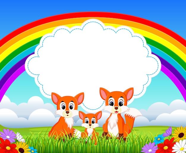 Netter fuchs mit regenbogenhintergrund