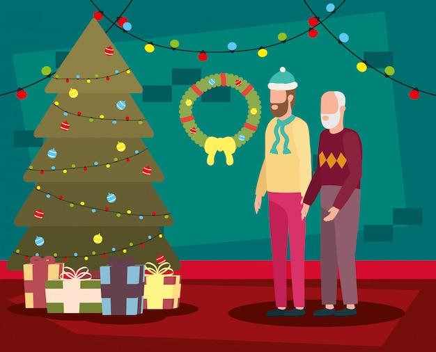 Netter großvater mit jungem sohn im raumweihnachten verziert