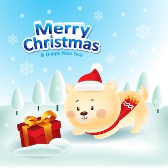 Netter hund mit der roten kappe und rotem schal, die eine geschenkbox für weihnachten spielen