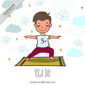 Netter junge auf einem teppich hintergrund macht yoga