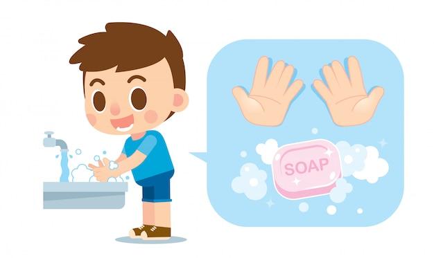 Netter junge, der hände mit seife und handikone wäscht