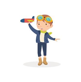 Netter junge, der mit flugzeugspielzeug spielt