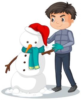Netter junge, der schneemann auf weiß bildet