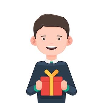Netter junge mit einer geschenkbox