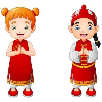 Netter junge und mädchen der karikatur im chinesischen kostüm
