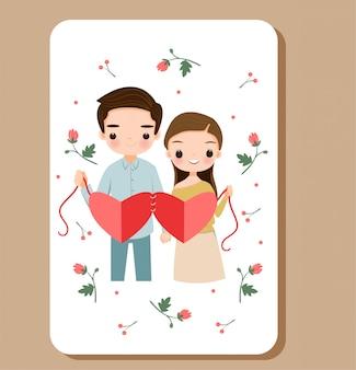 Netter junge und mädchen, die liebe mit blume für valentinstag zeigt