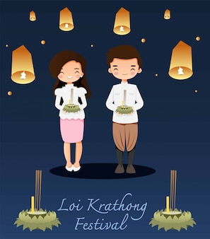 Netter junge und mädchen im trachtenkleid bereiteten sich vor, loi krathong festival zu tun