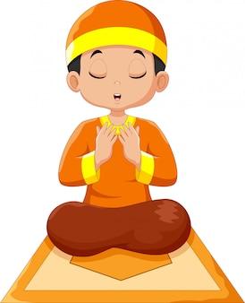 Netter jungenkarikatur, der betet