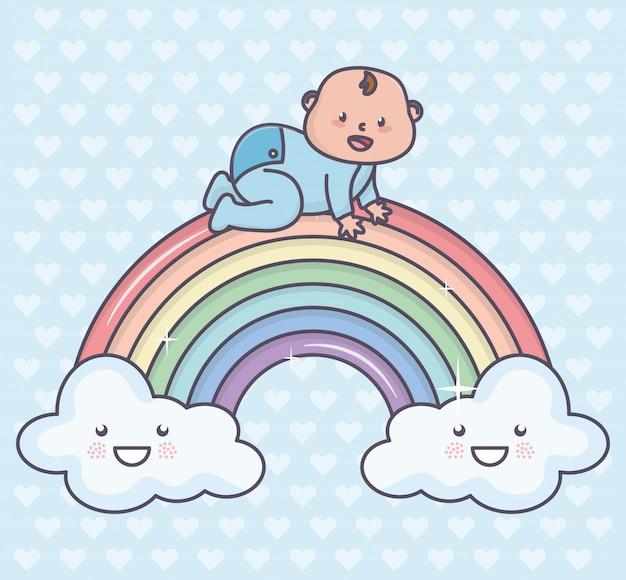 Netter kleiner junge der babyparty im regenbogen