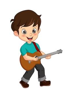 Netter kleiner junge, der gitarre spielt