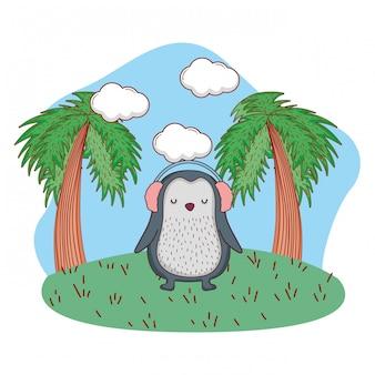 Netter kleiner pinguin mit kopfhörern im park