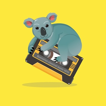 Netter koala, der alte bänder reitet