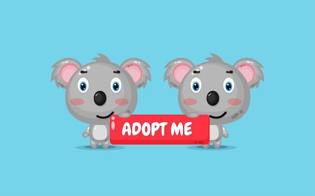 Netter koala, der ein adoptivzeichen hält