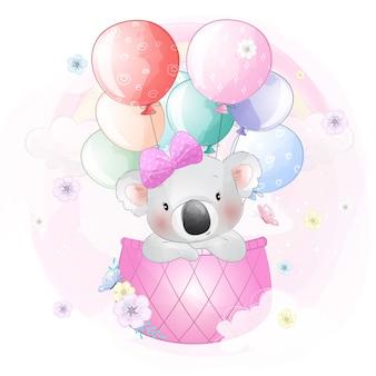 Netter koala, der mit luftballon fliegt