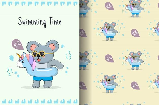 Netter koala mit blauem einhorngummiring nahtlosem muster und karte