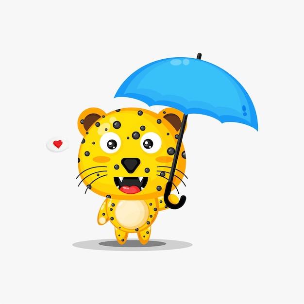 Netter leopard, der einen regenschirm trägt