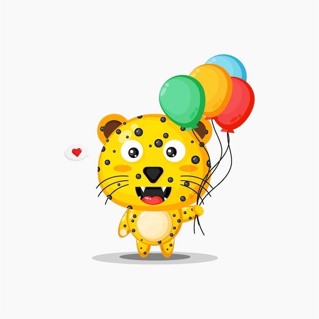Netter leopard, der luftballons trägt