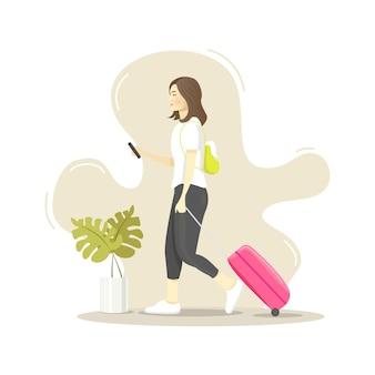 Netter moderner reisender, der ihr telefon beim gehen überprüft