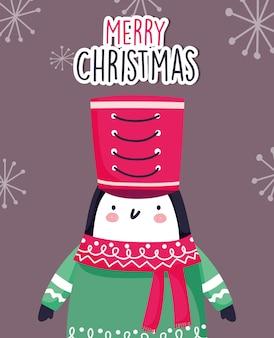 Netter pinguin der feier der frohen weihnachten mit hut und schal