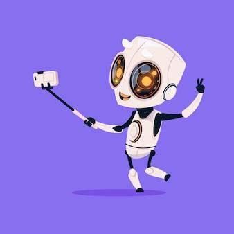 Netter roboter nehmen selfie foto lokalisiertes symbol auf blauem hintergrund-moderner technologie-künstlicher intelligenz