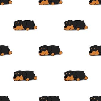 Netter rottweiler welpe, der nahtloses muster schläft