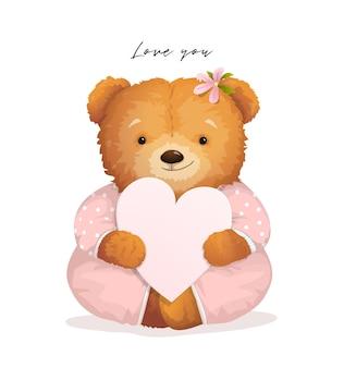 Netter teddybär, der ein herz hält.