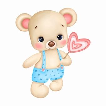 Netter teddybär im blauen overall mit rosa süßigkeitsherz auf weißem hintergrund