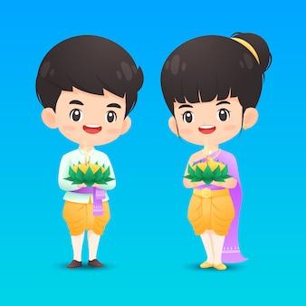 Netter thailändischer jungen- und mädchencharakter im traditionellen kostüm