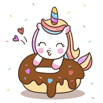 Netter unicorn vector, der donut isst