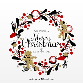 Netter weihnachtskranz verziert mit lebkuchenplätzchen