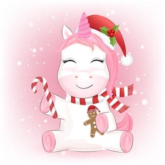 Nettes baby-einhorn und lebkuchenkarikaturhand gezeichnete weihnachtszeit-aquarellillustration