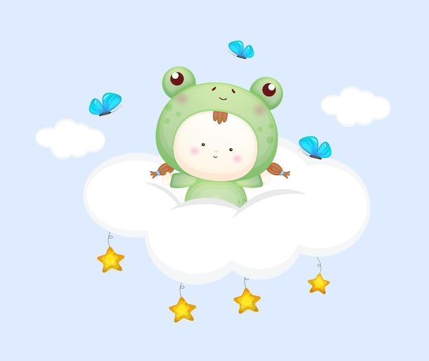 Nettes baby im froschkostüm auf der wolke. maskottchen-karikaturillustration premium-vektor