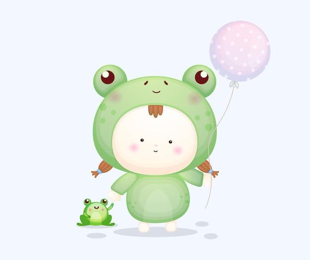 Nettes baby im froschkostüm, das ballon hält. maskottchen-karikaturillustration premium-vektor