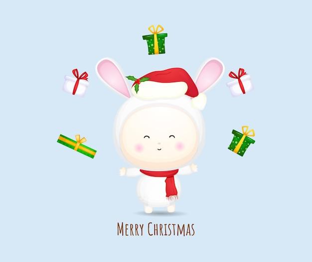 Nettes baby-sankt-kostüm mit geschenk für frohe weihnachten-illustrationssatz premium-vektor