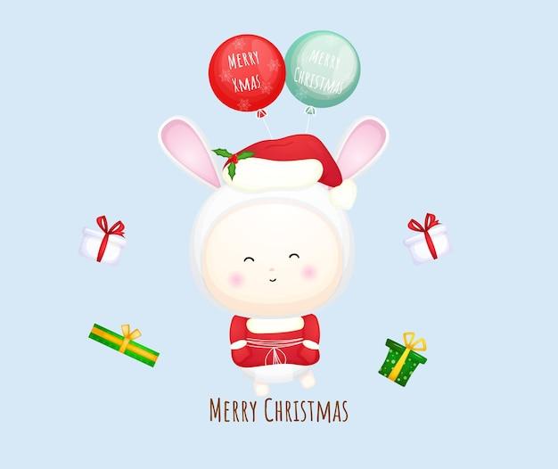 Nettes baby weihnachtsmann, das mit ballon für frohe weihnachten-illustration fliegt premium-vektor