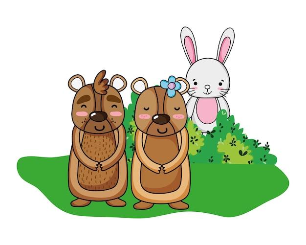 Nettes bärenpaar mit kaninchen im busch