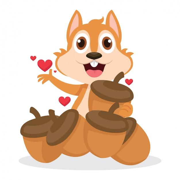 Nettes eichhörnchen sehr glücklich, nachdem viele eicheln erhalten worden sind