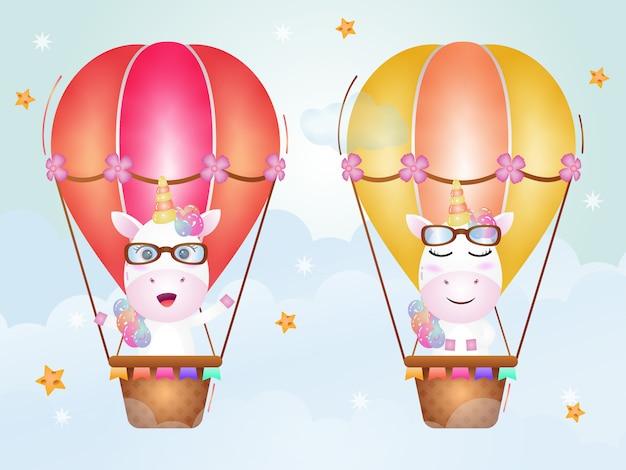 Nettes einhorn auf heißluftballon