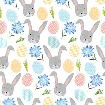 Nettes frohes ostern nahtloses muster mit grauen kaninchen der karikatur, bunten eiern und blumen