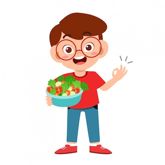 Nettes glückliches kind mit gemüse