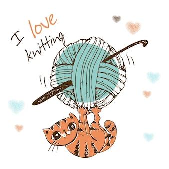 Nettes kätzchen, das mit einem wollknäuel spielt. ich liebe stricken.