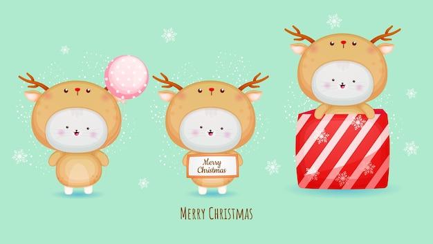 Nettes kätzchen im hirschkostüm für frohe weihnachten mit illustrationssatz premium-vektor