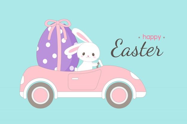 Nettes kaninchen, das großes osterei in einem auto trägt.
