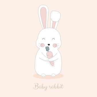 Nettes kaninchen, das karotte hält.