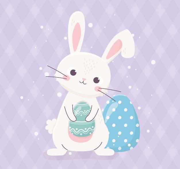 Nettes kaninchen des glücklichen osters hält eierdekorationsfeier